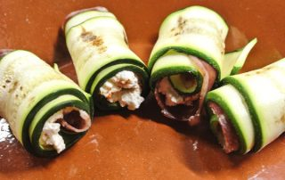 Zucchini filled with ham and ricotta