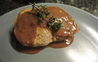 Escalope with red wine and orange sauce
