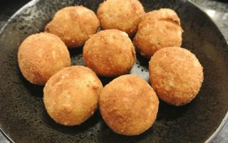 Risotto balls filled with tomato and mozzarella