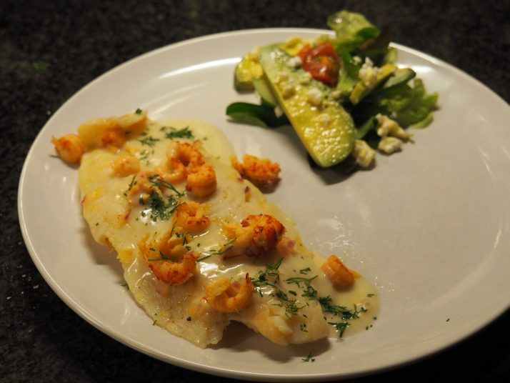 Poached fish with a smooth white wine sauce tempting for Poaching fish in wine