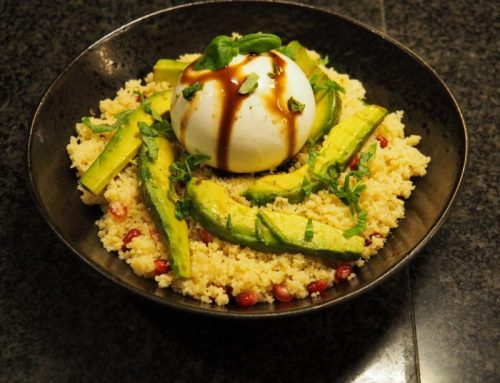 Couscous salad with pomegranate, grilled avocado and burrata