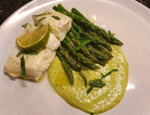 Poached catfish with asparagus and avocado